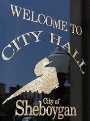 The sign on the door of Sheboygan's City Hall as seen