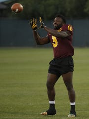 Running back Eno Benjamin catches passes during a spring practice last week.