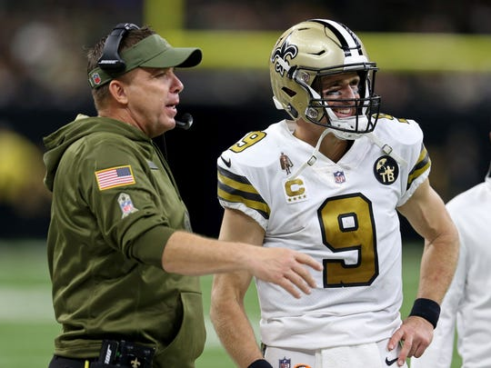 Nov 18, 2018; New Orleans, LA, USA; New Orleans Saints head coach Sean Payton and quarterback Drew Brees (9) on the sidelines in the fourth quarter against the Philadelphia Eagles at the Mercedes-Benz Superdome. The Saints won, 48-7. Mandatory Credit: Chuck Cook-USA TODAY Sports