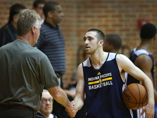 Indiana State Men's basketball standout Jake Odum worked out, along with 5 other college basketball standouts, for the Pacers Thursday morning at Bankers Life Fieldhouse. Here Odum greets Larry Bird following practice. Matt Kryger / The Star