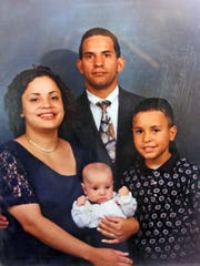 A family photo of Mirna and Raul Laguerre of Newburgh