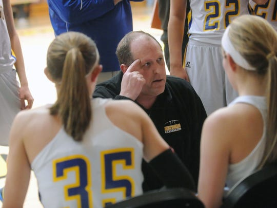 Mukwonago girls basketball coach Todd Frohwirth talks to his players durning a time out late in a playoff game in 2013. Frohwirth led MHS to the state-championship game, where it fell to Milwaukee Riverside. Frohiwrth, 54, was reportedly found dead March 26, 2017.