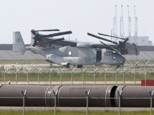 An Osprey aircraft is unloaded from a cargo ship at the U.S. Marines' base in Iwakuni city in Yamaguchi prefecture, western Japan, in 2012. Lt. Benjamin Frederick, who attended Mount Mansfield Union and whose parents live in Underhill, died at the base  Saturday, Dec. 17, 2016.