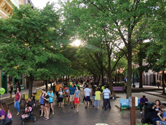 The Ped Mall in Downtown Iowa City comes alive in the