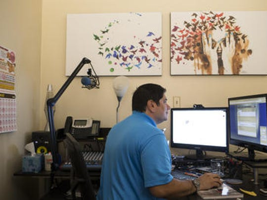 Zachary Garcia working in his office at Chromis Technology in Tempe.