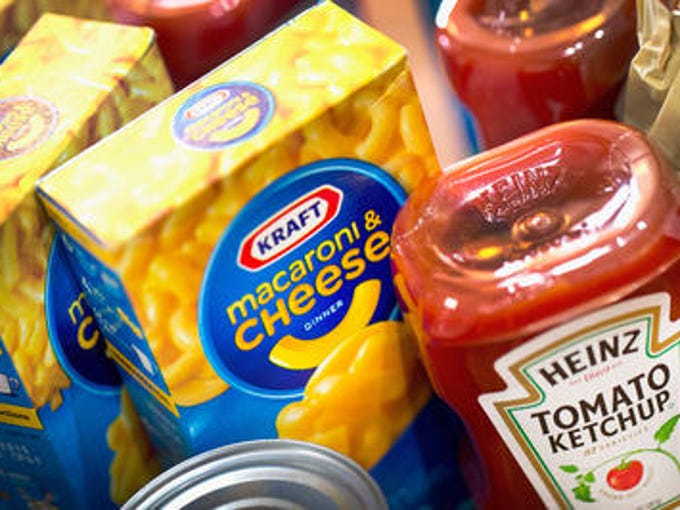 In this photo illustration, Kraft and Heinz products