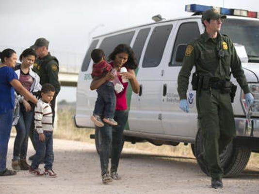 635767212514637117-migrants