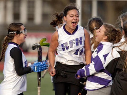 Emma Fitzgerald celebrated after Rumson-Fair Haven field hockey won the program's first sectional title in 2012.