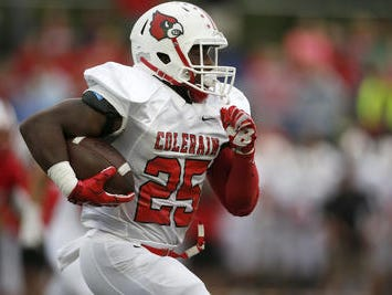 Colerain junior fullback Monalo Caldwell has rushed for 1,276 yards and 18 touchdowns for the Cardinals this season.