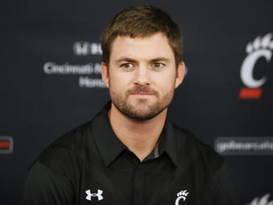 New University of Cincinnati offensive coordinator Zac Taylor meets the media at his introductory press conference at Fifth Third Arena.