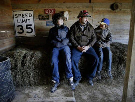 Jonathan Lawler and sons Elijah, 13, and Daniel, 10,
