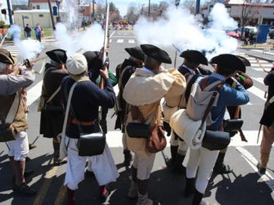 Continental reenactors fire on the British renactors on Main Street in South Bround Brook during the 2015 reenactment.