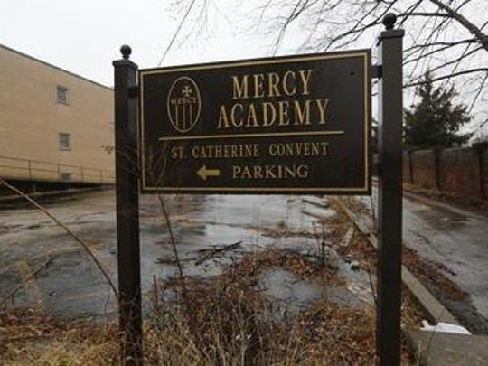 A Mercy Academy sign stands in back of the vacant property on East Broadway in 2015.