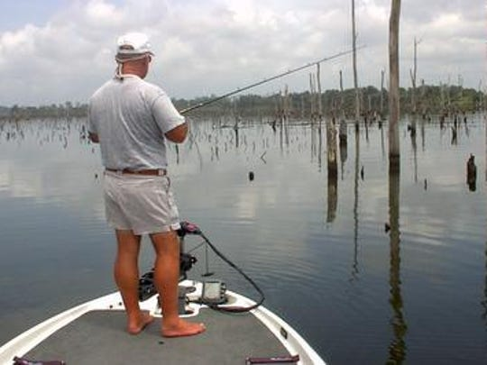 Professional fishing guide Homer Humphreys casts into