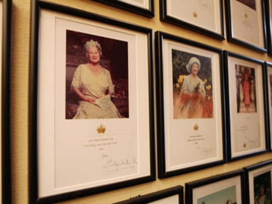 This Desert Sun file photo shows Christmas cards from Queen Elizabeth. They were on display at the Annenberg Retreat in 2013.