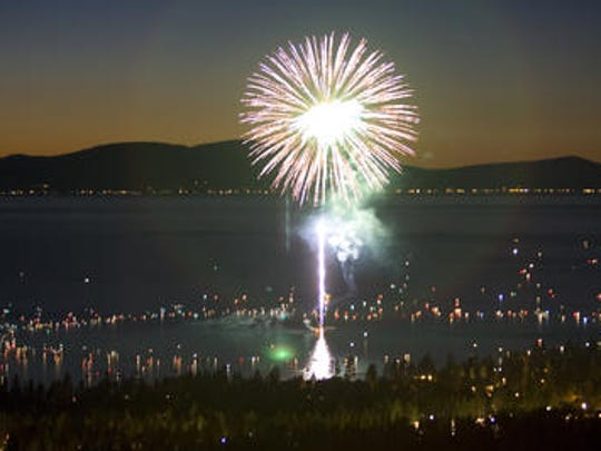 Fireworks exploding over Lake Tahoe as seen from Heavenly Mountain Resort.