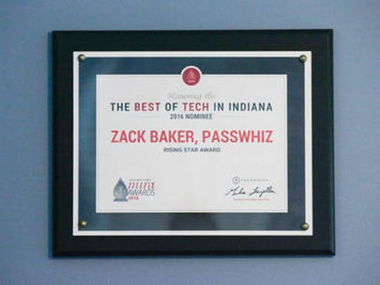 Eighteen-year-old Zack Baker's Best of Tech in Indiana Rising Star Award for PassWhiz hangs on the wall in his room in Noblesville. PassWhiz is a hall pass application. Baker created his first app as a freshman in high school.