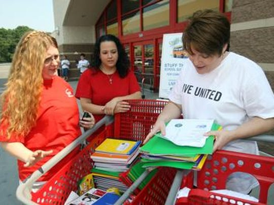 United Way supporters participate in Stuff the Bus