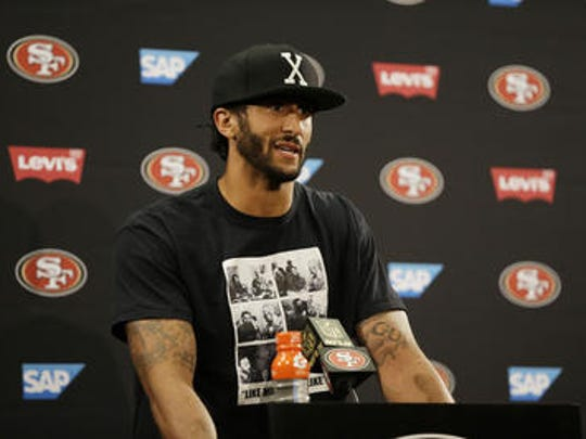 San Francisco 49ers quarterback Colin Kaepernick answers questions at a news conference after an NFL preseason football game.