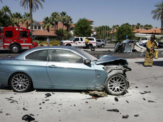 A BMW 328 i was destroyed in a collision on Highway 111 in Rancho Mirage on June 18, 2013. Its driver is accused of street racing with another defendant just before the collision.