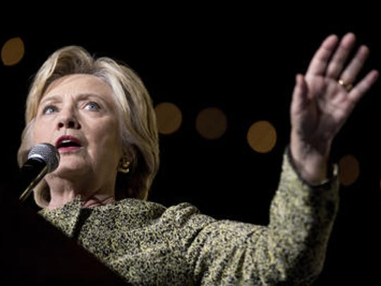 Democratic presidential candidate Hillary Clinton is trying to make small public appearances but not headlines, instead letting rival Donald Trump's campaign damage itself.