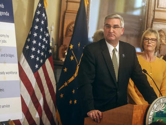 Gov.-elect Eric Holcomb announces his legislative agenda, including his budget priorities for the first regular session of the 120th Indiana General Assembly, at the Indiana Statehouse, on Jan. 5. Lt. Gov.-elect Suzanne Crouch listens at right.
