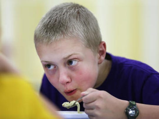 Wyatt Rademan, 9, of Pittsville, blows on his soup