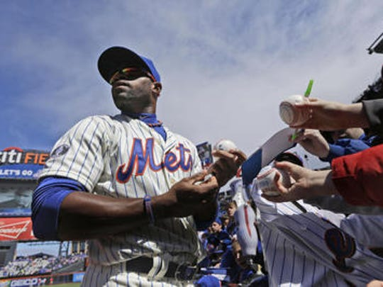 New York Mets' Eric Young Jr. signs autographs before a game against the Washington Nationals on Opening Day at Citi Field in New York, Monday, March 31, 2014.