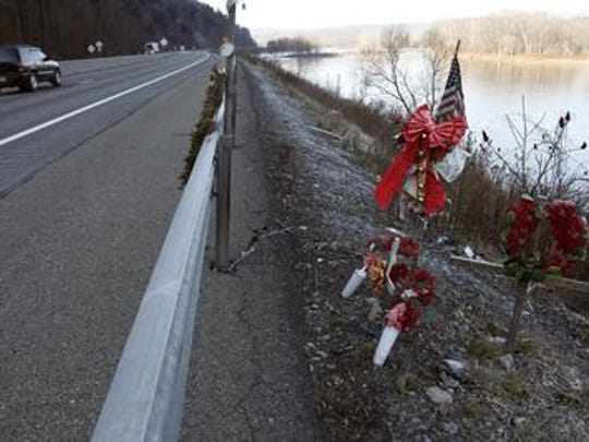 Flags, ribbons, crosses and other memorabilia are set in 2012 on Interstate 88, where the vehicle driven by Jaclyn S. Wesley, of Binghamton, crashed into the Chenango River, killing three passengers, in May 2011.