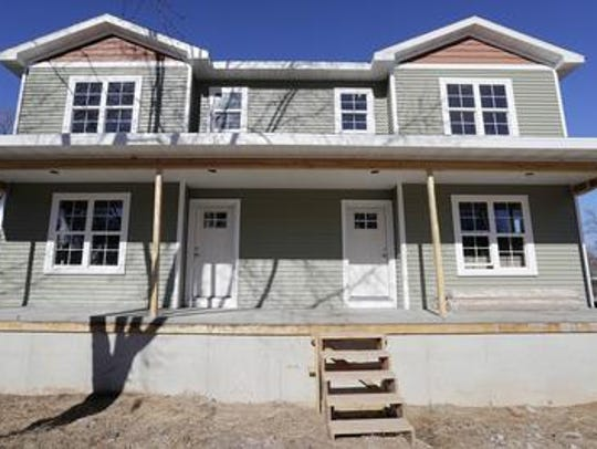 Greater Green Bay Habitat for Humanity has added a low-income home repair program this year. The nonprofit has largely focused on building new, affordable homes, like this twin-home completed in 2017, for most of its history.