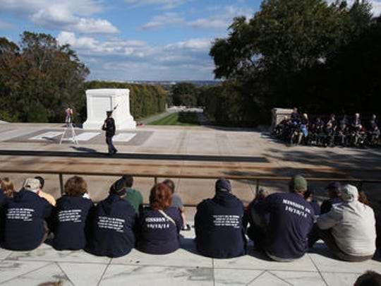 A soldier guards the Tomb of the Unknown Soldier at