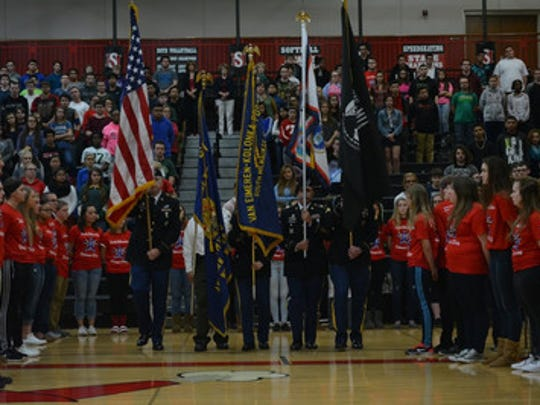 The colors are presented at an event honoring veterans at South Milwaukee High School.