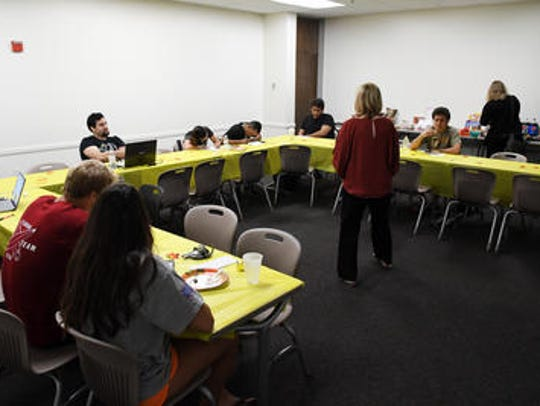 Students enjoy the food during Saturday's Thanksgiving