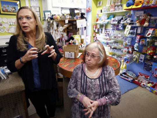 Toymasters owner Denise Zappoli (left) is shown with