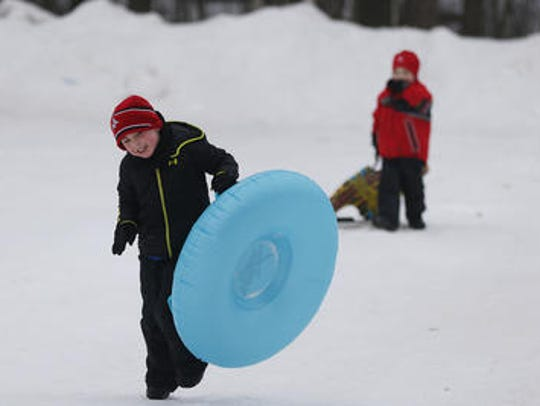 Enjoy three sled and saucer hills at Iverson Park in