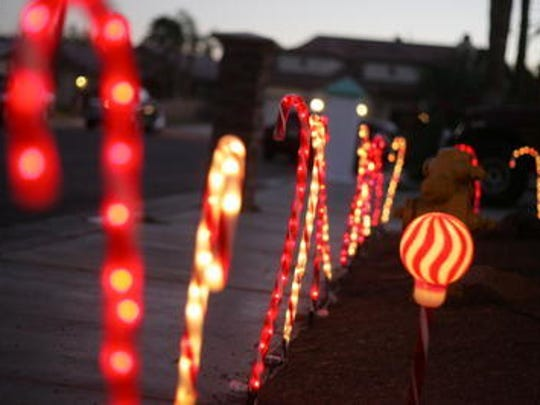 This Desert Sun file photo shows Minerva Road, which is known as Candy Cane Lane in December due to all the decorated homes.