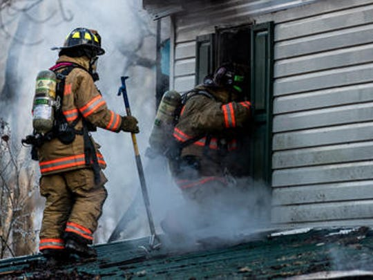 Firefighters work at the scene of a second alarm fire on the 7200 block of Three Ponds Lane on New Year's Day, Monday, Jan. 1, 2018 in Manheim Township. No injuries were reported from the blaze, and the homeowner was not home at the time of the fire, according to Lt. Krebs of the Lineboro Fire Department.