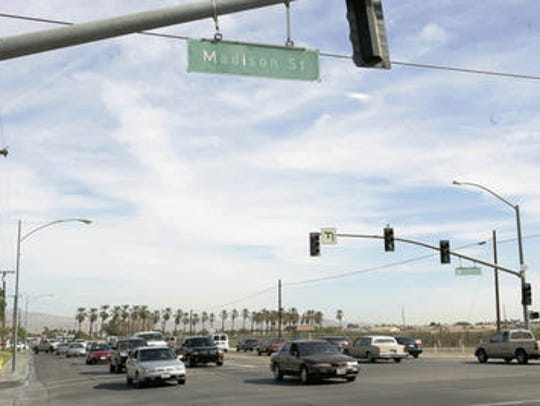 This Desert Sun file photo shows Highway 111 at Madison Street in Indio. The intersection is the east end of a slurry seal project that's happening this week on a one-mile stretch of road.