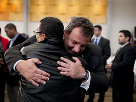 Gov. Chris Christie hugs Camden activist Angel Cordero at a November 2011 event in Camden to announce a prisoner re-entry initiative.