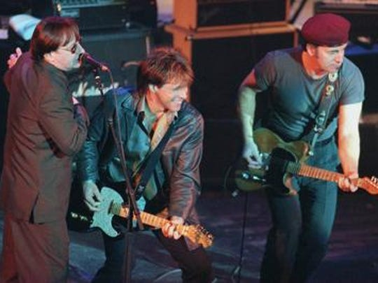 "Southside Johnny Lyon (l), Jon Bon Jovi and Bruce Springsteen onstage during the opening song, ""This Time It's For Real"" at Come Together: a Benefit for the family of Sgt. Patrick King, Jan. 31, 1998 at the Count Basie Theatre, Red Bank."