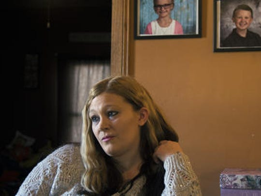 Julie Straw speaks about Daniel Martz, the father of her oldest child, in her home in Wisconsin Rapids, Wis., January 27, 2018.