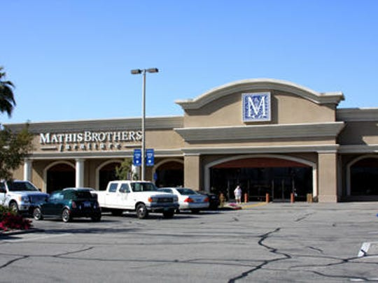 This Desert Sun file photo shows Mathis Brothers furniture store in Indio. A woman died this weekend after being set on fire outside the store last month. Her son is a suspect and remains in custody.
