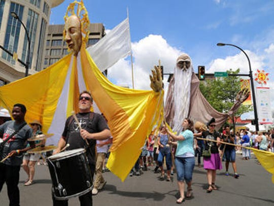 Street performers and parades are part of Artisphere