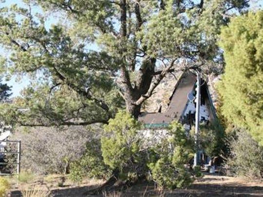This 2006 photo shows the Pinyon Pines home where three