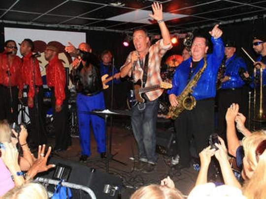 Bruce Springsteen joins members of the Soul Cruisers during a salute to the late Clarence Clemons at the Wonder Bar in Asbury Park.