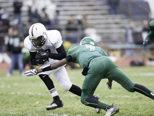 Charles Lovett moves in to tackle North Plainfield's