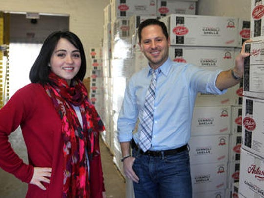 Anthony Artuso, Jr., the CEO of Artuso Pastry Corp. in Mount Vernon, and his sister Concetta Artuso Mangano, the marketing coordinator, are photographed Jan. 25, 2012 in the Mount Vernon warehouse. The family business that started in the Bronx in 1946 is expanding by opening a retail store in Mamaroneck and by expanding its bakery to sell wholesale in more supermarkets.