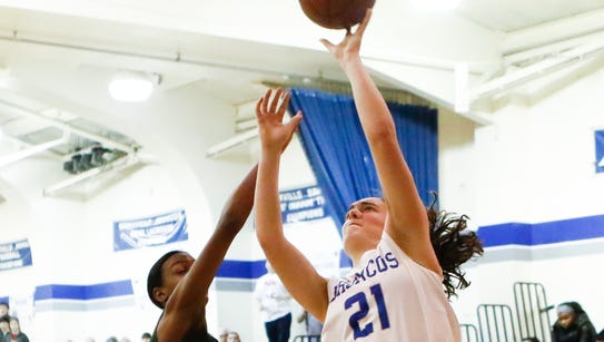 Bronxville's Olivia Jensen (21) puts up a shot against