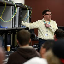 Al Fencl teaches his CISCO 1 class at Northeast Wisconsin Technical College in Green Bay on Thursday.