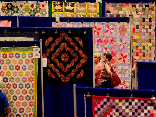 People check out all the quilts on display during the